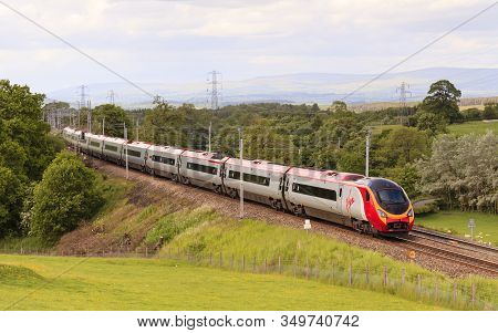 Hackthorpe, England - June 15:  A Virgin Pendolino Heads North Through Hackthorpe, Cumbria On June 1