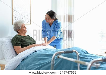 Care Worker With Elderly Woman In Geriatric Hospice