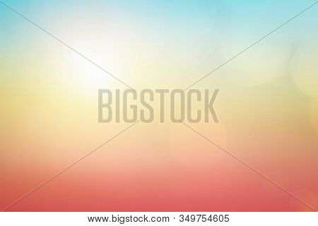 Natural Background Blurring Warm Colors And Bright Sunlight. Bokeh Or Christmas Background Blue Sun