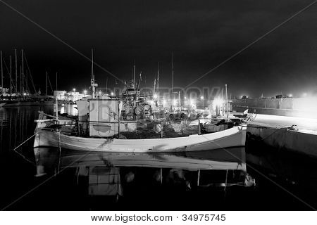 Formentera La savina port marina with traditional fisher boats black and white