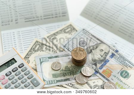 Personal Financial Planning Concept. Dollar Money On Bank Account Passbook With Calculator On Desk.