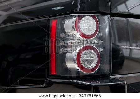 Novosibirsk, Russia - 02.07.2020: Black Used Land Rover Range Rover Supercharger 2010 With Rear Tail