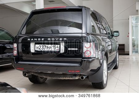 Novosibirsk, Russia - 02.07.2020: Black Used Land Rover Range Rover Supercharger 2010 With Rear View
