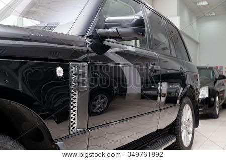 Novosibirsk, Russia - 02.07.2020: Black Used Land Rover Range Rover Supercharger 2010 With Side View