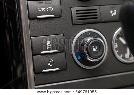 The Button For The Stability Control System, Side Mirrors Adjust And Headlight Washer On Black Panel