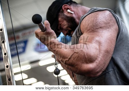 Muscle Biceps Workout Training By Young Strong Man Lifting Heavy Weight With Hard Tension Stress On