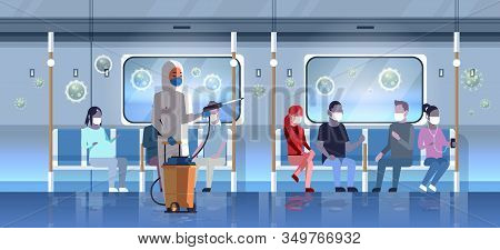 Specialist In Hazmat Suit Cleaning And Disinfecting Coronavirus Cells In Public Transport With Passe