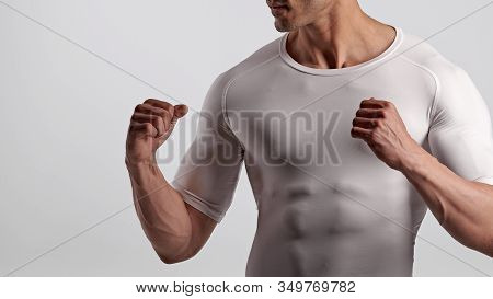 Strong Muscular Male Fighter Showing Fists, Closeup Photo
