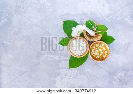 Top View Of Set For Relaxing Healing Thai Spa Treatments. Wooden Mortar Pounder With Herbs, Bowl Wit