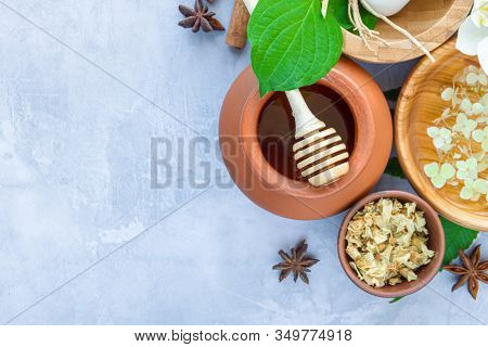 Top View Of Set For Relaxing Healing Thai Spa Treatments. Wooden Mortar Pounder With Herbs, Honey Po