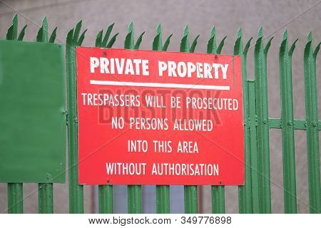 Trespassers Will Be Prosecuted Private Property Sign Red On Green Fence