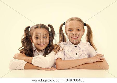 Lesson Where Learning Begins. Cute School Children Sitting At School Desk. Little Schoolgirls Having