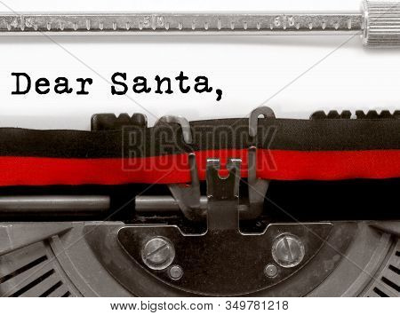 Dear Santa Text Written By A Typewriter On White Paper Sheet