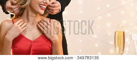Unrecognizable Woman Getting Golden Necklace From Her Boyfriend For Valentines Day During Romantic D