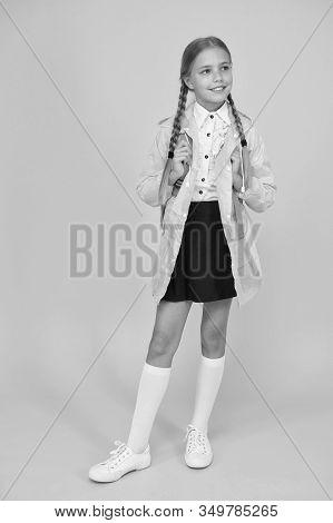 Rain Is Not Hindrance. Waterproof Cloak. Schoolgirl Wear Green Raincoat Going To School. Waterproof