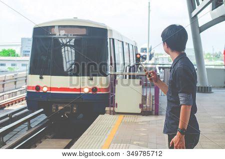 Bangkok Thailand, April 7,2019 : Asian Man Passenger Using Smartphone And Looking Bts In Train Stati