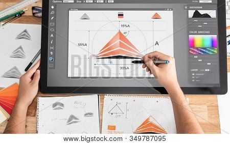 Graphic Designer Drawing Sketches Logo Design. The Concept Of A New Brand. Professional Creative Occ