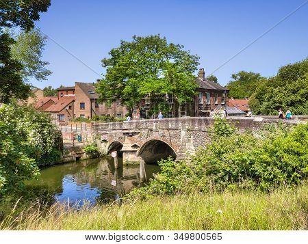 29 June 2019: Norwich, Norfolk, Uk - Bishop Bridge, The Original Of Which Was Built In 1340, Spannin