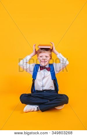 Young Atractive Boy Wearing School Unifor While Holding His School Books On Heard