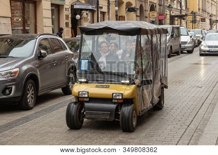 Krakow, Poland - April, 2019: Pleasure Passenger Electric Car Melex 986 With Tourists Viewing The St