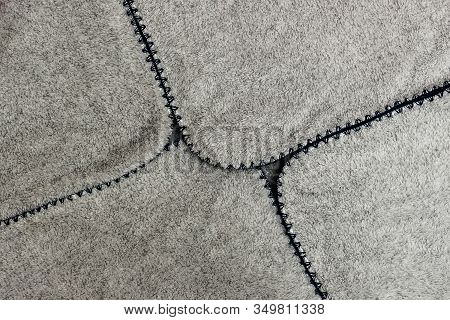 Gray Spathe Folded In An Envelope With Blue Threading Edges. Close-up Of Natural Warm Wool Coverlet,
