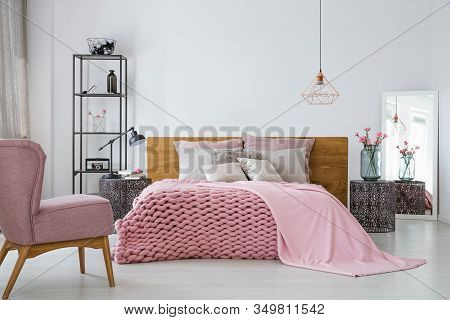 Pink Cozy Woolen Blanket And Duvet On King Size Bed In Contemporary Bedroom Interior, Copy Space On