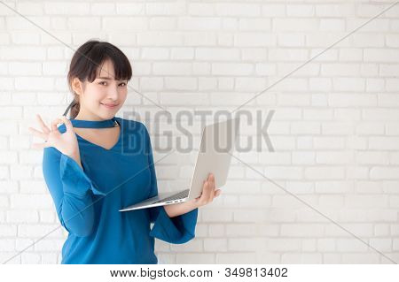 Beautiful Freelance Young Asian Woman Confident Using Laptop Computer Online Internet With Success,