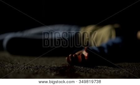 Dead Female Victim Lying In Puddle Of Blood, Road Accident, Manslaughter