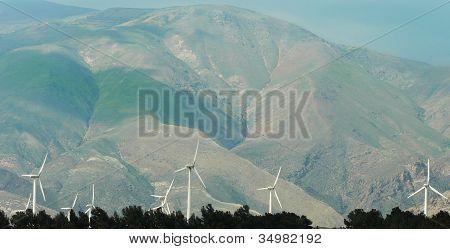 wind turbine for alternative energy in sunset