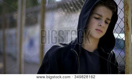 Boy In Hoodie Leaning On Fence, Orphan In Boarding School, Confinement
