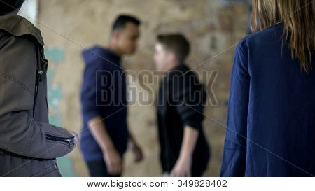 Teenage Boys Fighting, Bullying And Self-defense, Violence, Blurred Background