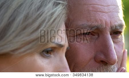 Old Upset Woman Supporting Her Ill Crying Husband, Incurable Disease, Support