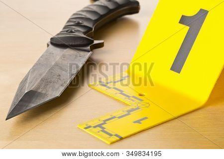 Crime Scene Investigation Csi Evidence Marker With Knife On Wooden Floor Background At Crime Scene -