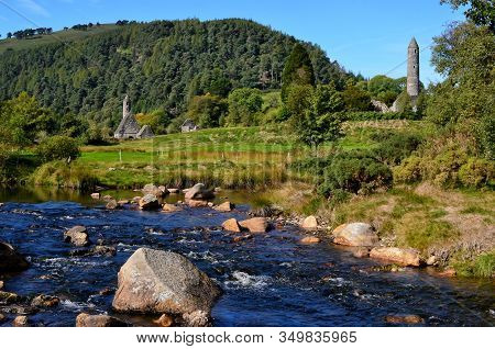 Landscape With River And Celtic Round Tower Glendalough