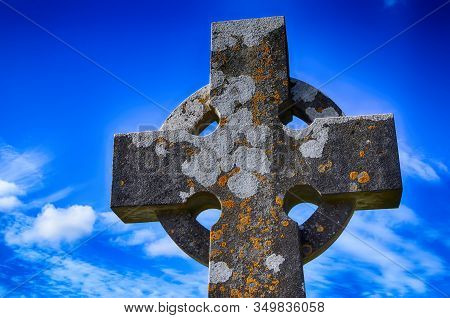 Detail Of Old Ireland Celtic Stone Cross In Cemetery At Blue Sky