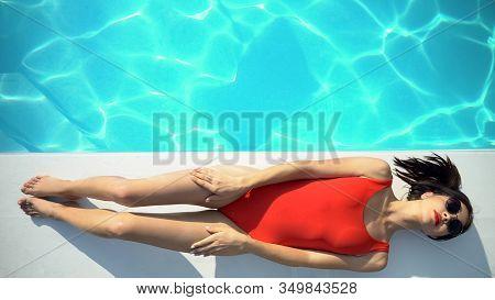Beautiful Young Woman In Swimwear Top View, Hot Lady Sunbathing Near Pool