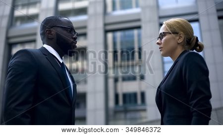 Male Boss Scolding Subordinate, Employee Justifying Herself, Business Ethics