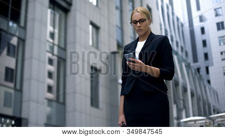 Sad Business Lady Looking At Phone, News About Failed Contract And Lost Money