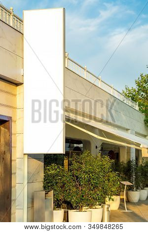 Empty Billboard Hanging On The Wall Of The Building At The Entrance To The Catering Facility, In The