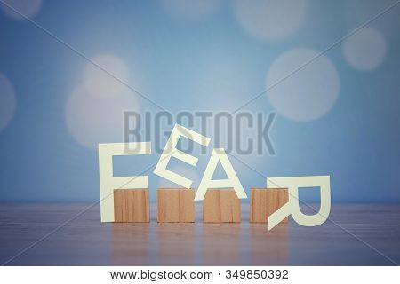 Fear. Single Word. With Wooden Blocks On Blue Background. Motivational Text With Vintage Style Desig