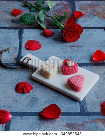 Heart Shaped Marzipan Candy And A Rose For Valentine's Day