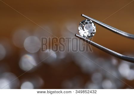 Painstaking Jewelry Work, Looking At Diamond. Master Holds Small Gem With Tweezers. In Foreground, T