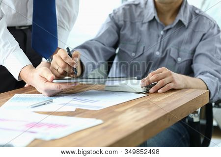 Signing Electronic Document On Tablet With Stylus. Company Employee Holds Electronic Device In His H