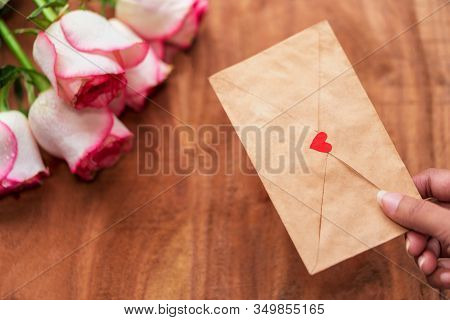 Hand Giving Love Letter