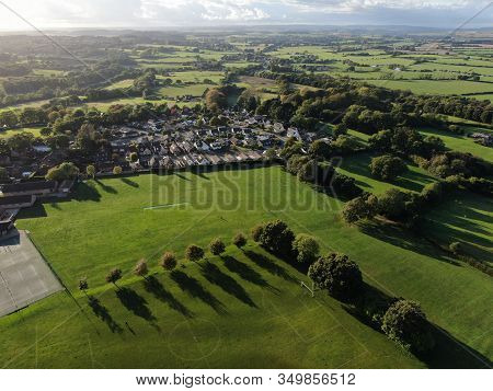 Aerial View Of Parkland Showing Fields And Hedgerows In Evening Sunshine