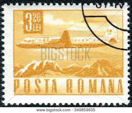 Romania - Circa 1968: A Stamp Printed In Romania, Depicted Ilyushin Il-18 Airliner Over Mountain Lan