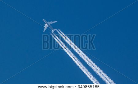 Aircraft At High Altitude. Antonov Cargo Plane On A Blue Sky. Trace From The Plane. Inversion Trace.