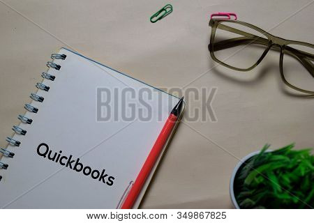 Quickbooks Write On A Book Isolated On Office Desk