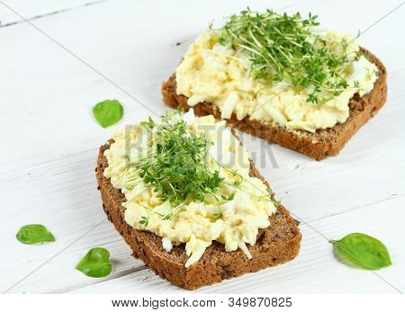 Egg Salad Over Brown Bread With Garden Cress. White Background.  Homemade Spread Made From Eggs, May