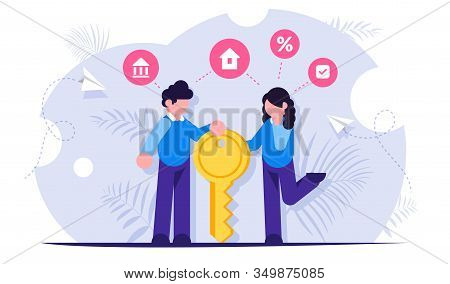 Happy Family Stands With The Key To Their New Home Or Apartment. Concept Of A Mortgage Loan For The